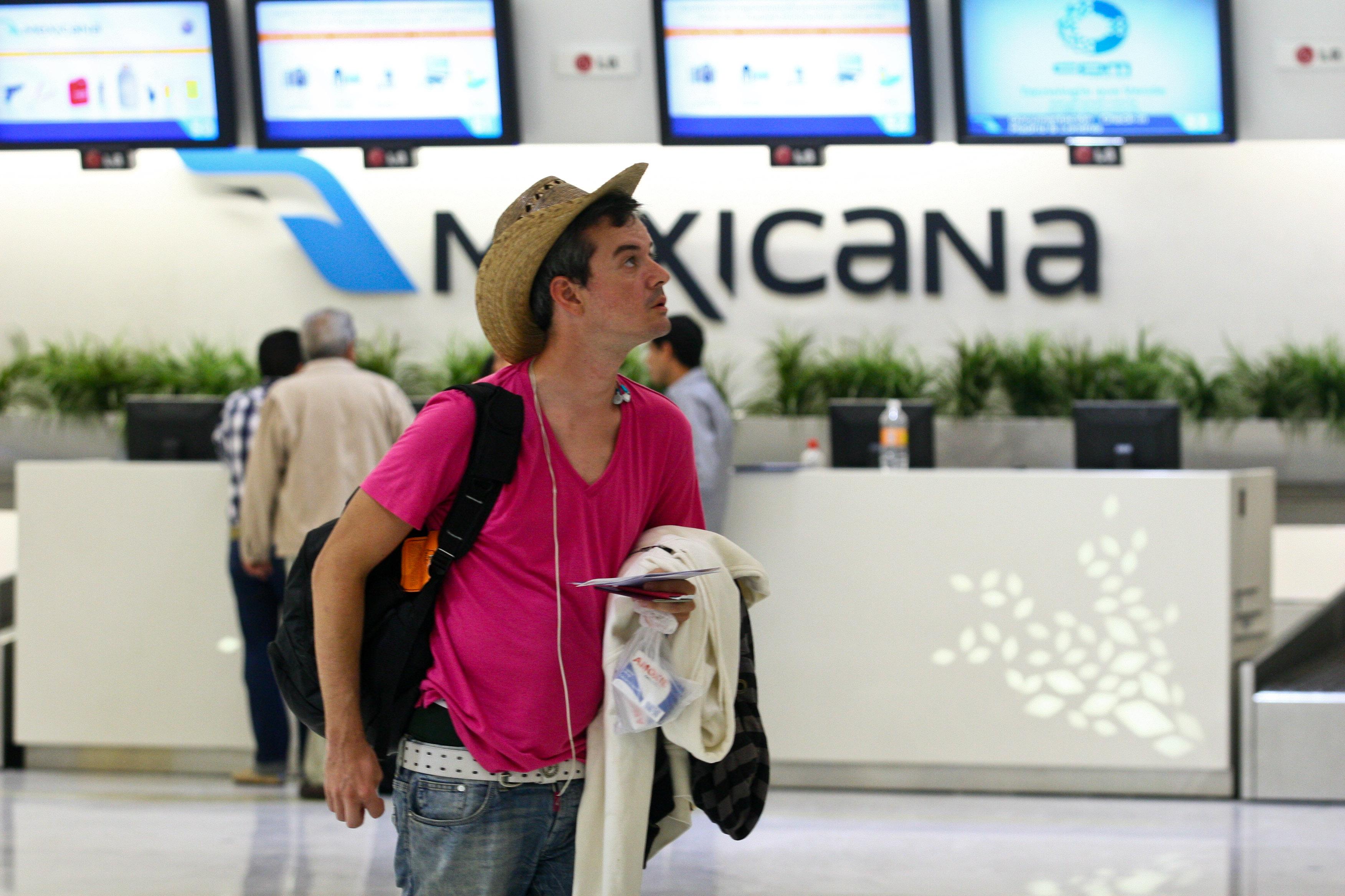 mostrador de Mexicana en aeropuerto