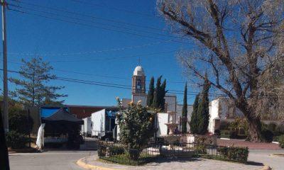Contiene imagen exterior, construcción, torre, árboles, plaza